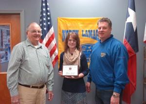 VFW Commander Bud Mackey, left, and North Lamar High School Principal Clint Hildreth congratulate NLHS English instructor Melissa Arnold on the VFW Citizenship Education Teacher award.