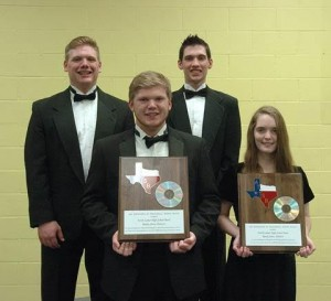 NLHS Band representatives Kevin Dawson, Jake Briscoe, Matt Wirges and Brittany Pilkington hold plaques presented by the Association of Texas Small School Bands that will hang in the band hall recognizing the group as being among the best concert bands in the State of Texas.