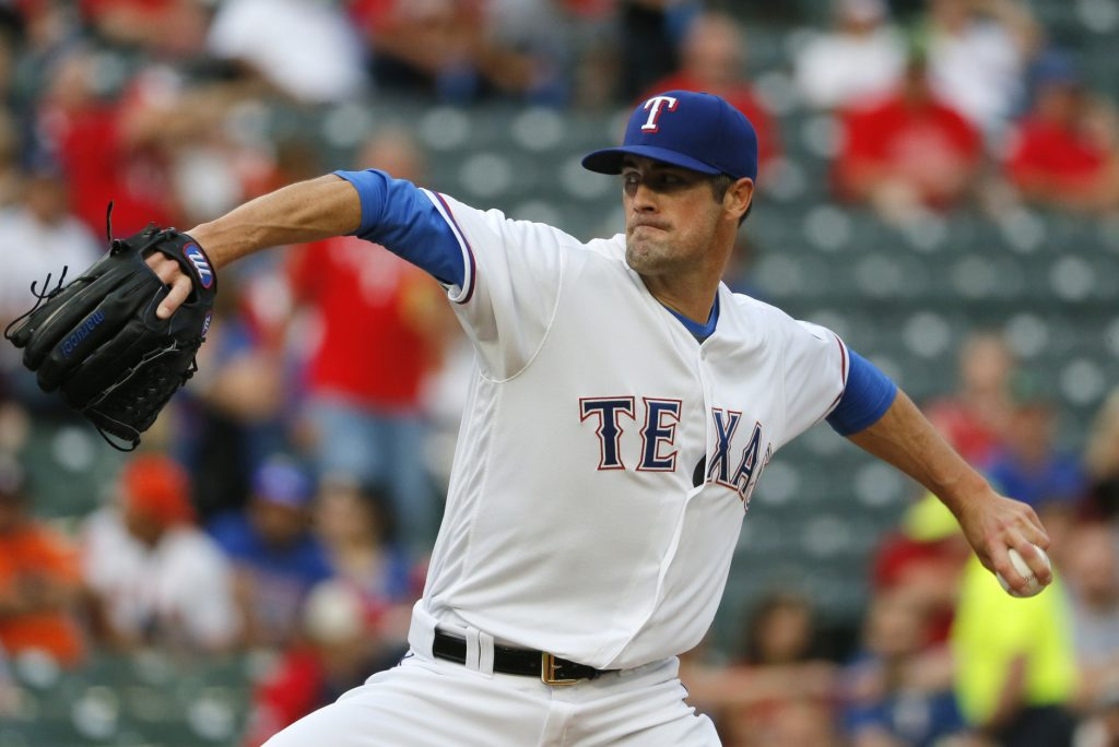 Texas Rangers starting pitcher Cole Hamels delivers to the Houston Astros in the first inning of a baseball game, Wednesday, April 20, 2016, in Arlington, Texas. (AP Photo/Tony Gutierrez)