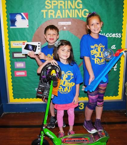 "Parker Elementary Winners   (L to R) 2nd place – Ryan Barnett – 7"" RCA Tablet 1st place – Miah Handlin - Razor Scooter 3rd place - Allison Moneyheffer – Launch board"