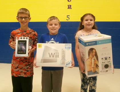 """Everett Elementary Winners (L to R) 3rd place – Tristan Peterson – 7"""" RCA Tablet 1st place – Carter Whitten – Wii U with Wii Sports and       Wii Sports Resort 2nd place – Sydney Garrett – Karaoke Singing Machine"""