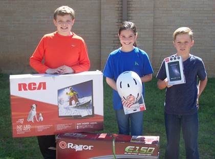 """Bailey Intermediate Winners (L to R) 1st place – Drew McNeal – 32"""" Flat Screen TV 2nd place – Sela Geeslin – Electric Scooter 3rd place – Cohen Rekieta – 7"""" RCA Tablet"""