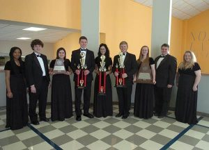 orth Lamar High School senior band members display trophies won by the Symphonic and Concert Bands.  From left are Taleia Anderson, Cory Burchfield, Dani Hicks, Grant Erickson, Arilynn Hostetler, Jake Briscoe, Sydney Wilson, Alfredo Berg and Faith Vickery.