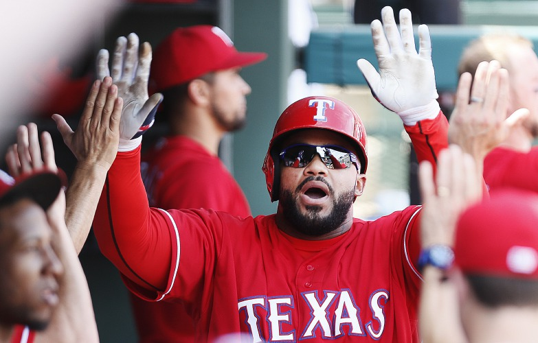 Texas Rangers designated hitter Prince Fielder is congratulated by teammates after hitting a two-run home run during the sixth inning of a baseball game against the Boston Red Sox, Sunday, June 26, 2016, in Arlington, Texas. (AP Photo/Brandon Wade)