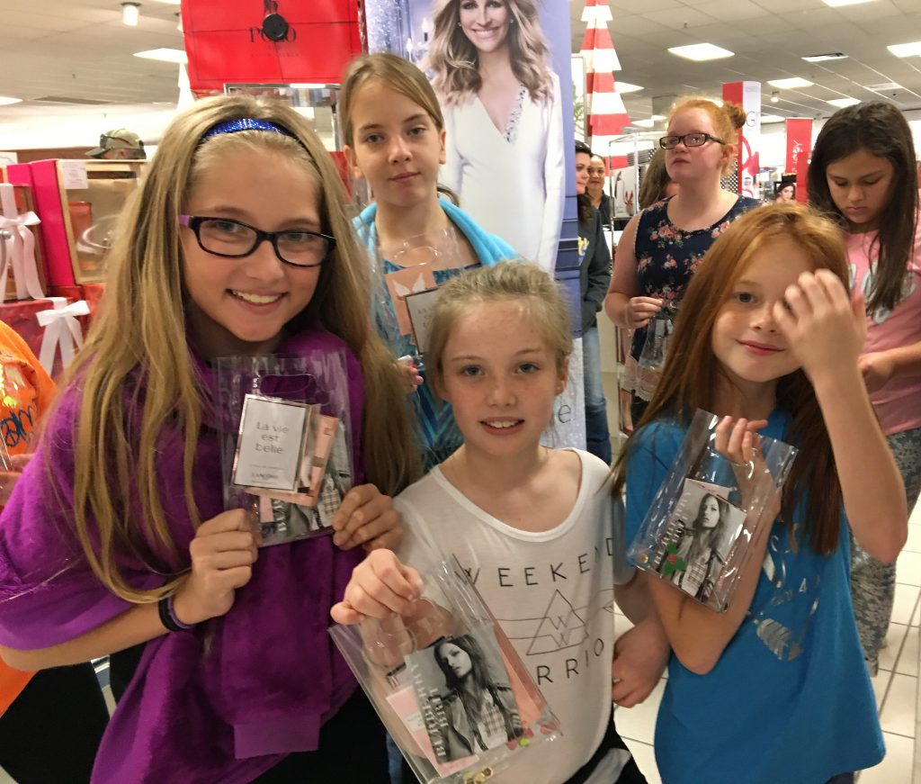 Showing cosmetic and perfume samples they received while touring Belk are members of the Bailey Intermediate School's Fashionista JUMP group.  Beginning front row left are Avery Scott, Amberlee Freelen, and Nadia Bowman.  Standing in back are Alexis Roberts, Emily Maggard, and Aleiya Resendiz.