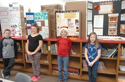 Bailey Intermediate 4th grade science fair winners beginning left are Karson King, Macy Howard, Dakota Berquist, and Amberlee Freelen.