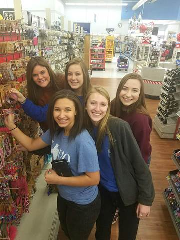 Shopping for Christmas angels brings back childhood memories for these North Lamar athletes.  Pictured in the jewelry aisle beginning front left is Olivia Reader and Karlie Ewell.  In back are Shiann Rice, Jaimelynn Parker, and Payton Fleming