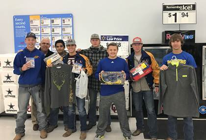 Members of the Panther football team shopped for such things as clothing, shoes, games, sporting gear, action figures, and Legos for their Christmas angels.  Football members pictured from left are Ryan Scott, Coach Michael Cowling, Steven Wisham, Austin Stephens, Nic Noble, Wesley Culbertson, and Sam Cowling.