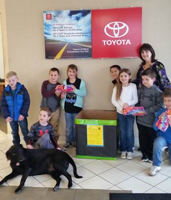 New child-sized blankets may be dropped-off at a number of local businesses.  Placing blankets in the box at Everett Toyota are Grady Thomison, Eli Green, Landon Kessel, Averee Bennett, Ryan Trenchard, Ella Chaffin, Higgins GT teacher Sonja Carter, Brody Byess, and Grey Gillem.
