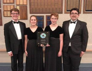Representing the North Lamar High School Symphonic Band with the 2016 Mark of Excellence/National Wind Band Honors plaque from left are Tanner Liles, Alex Phillips, Laura Daniel, and Donivan Mullens.