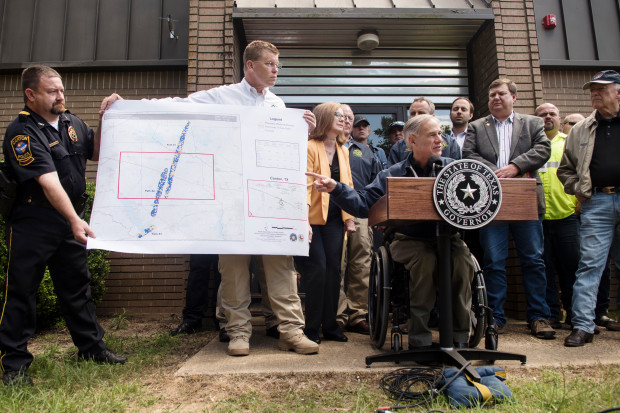 Texas Gov. Greg Abbott speaks during a news conference Sunday, April 30, 2017, in Canton, Texas. Severe storms including tornadoes swept through several small towns in East Texas, killing several people, and leaving a trail of overturned vehicles, mangled trees and damaged homes, authorities said Sunday. (Sarah A. Miller/Tyler Morning Telegraph)